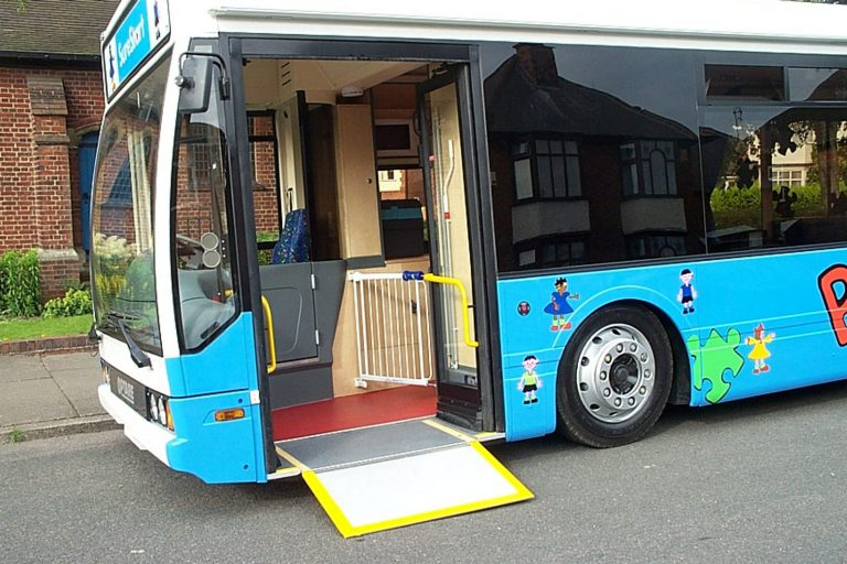 Converted bus with wheelchair ramp