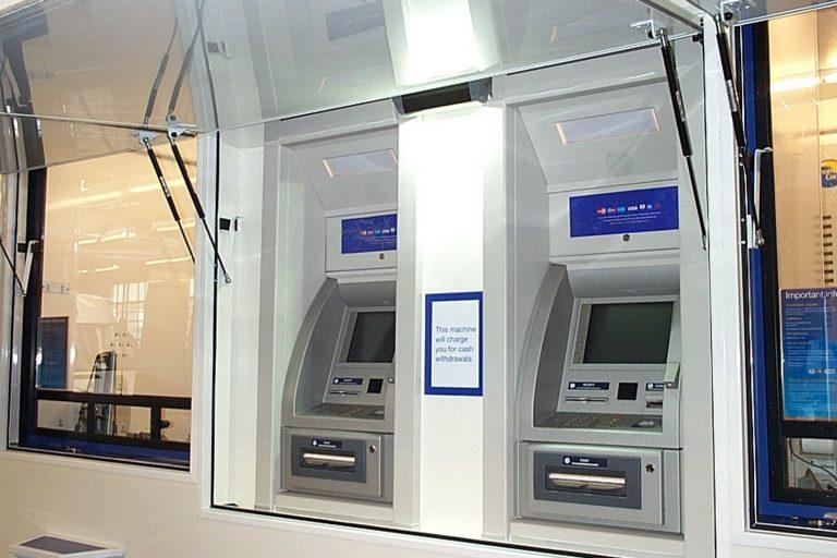 Cash dispensing kiosk