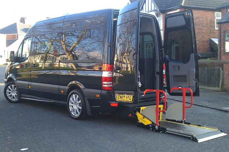 Minibus with rear passenger lift