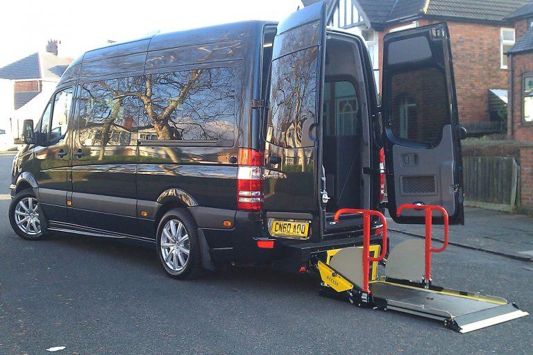 Minibus with rear passenger lift