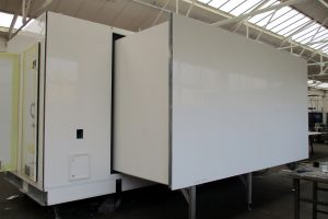 extension pod sliding out of the side of an exhibition trailer