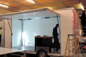 men building new chassis cab event vehicle