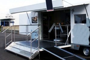 gull wing extension on trailer showing wheelchair ramp on platform