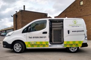 pawsitive vet care vehicle with side door open to reveal dog cage