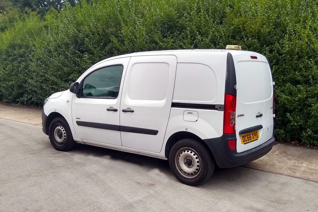 white mercedes Citan van with bushes in the background