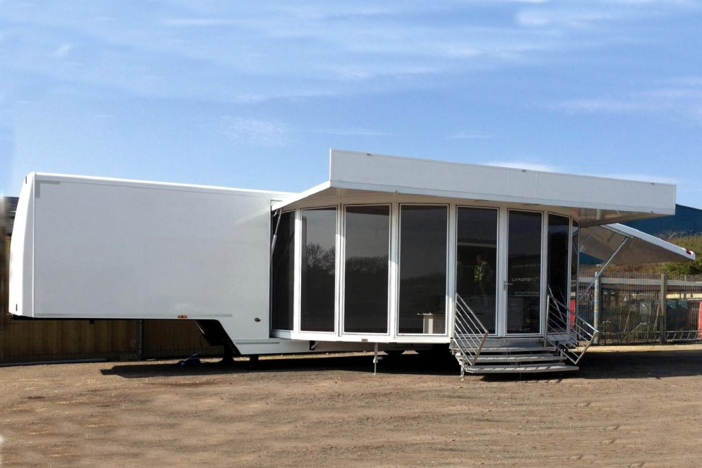 a 10 metre long articulated trailer with a glazed extension with entrance door and entrance steps